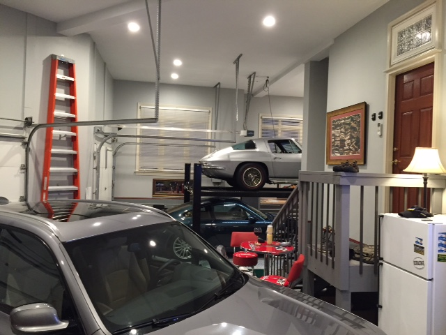 Platinum garage cabinets with smoke epoxy garage flooring